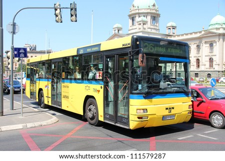 BELGRADE, SERBIA - AUGUST 15: Commuters ride a bus on August 15, 2012 in Belgrade, Serbia. Buses are public transport backbone in Belgrade. The 1000 bus fleet is operated by GSP Belgrade.