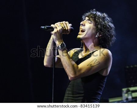 "BELGRADE, SERBIA - AUGUST 17 : Ferman Akgul, vocalist of Turkish band ""MANGA"" performs onstage at Belgrade BeerFest 2011 at ""Usce"" August 17, 2011 in Belgrade, Serbia. - stock photo"