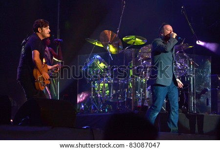 BELGRADE, SERBIA-AUGUST 18: Jim Kerr and Charlie Burchill the core of the band Simple Minds perform at the Belgrade Beer Fest on August 18, 2011 in Belgrade, Serbia. - stock photo
