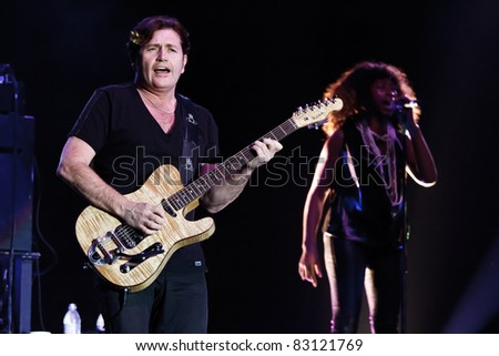 "BELGRADE, SERBIA - AUGUST 18 : Scottish pop rock music band ""SIMPLE MINDS"" performs at the Belgrade BeerFest 2011 at ""Usce"" on August 18, 2011 in Belgrade, Serbia. - stock photo"