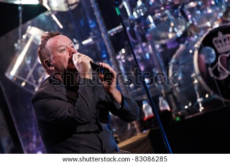 "BELGRADE, SERBIA - AUGUST 18 : Scottish pop rock music band ""SIMPLE MINDS"" performs onstage at Belgrade BeerFest 2011 at ""Usce"" August 18, 2011 in Belgrade, Serbia. - stock photo"