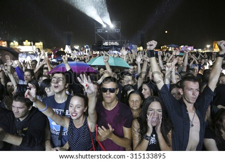 Belgrade, Serbia - August 19, 2015: The audience during a show at Traditional Beer Fest in Belgrade, next to good music to audience offered and beer, this year lasted 6 days. - stock photo