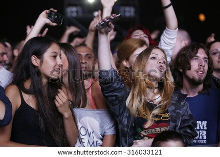 Belgrade, Serbia - August 20, 2015: The audience during a show at Traditional Beer Fest in Belgrade, next to good music to audience offered and beer, this year lasted 6 days. - stock photo