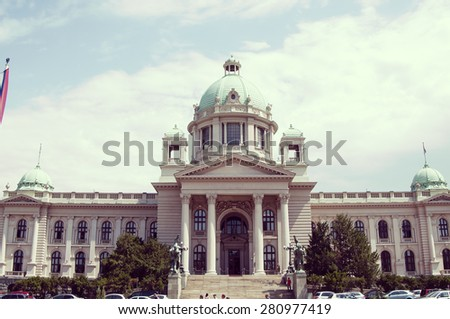 BELGRADE, SERBIA, August 4, 2014: The House of the National Assembly of Serbia is located on Nikola Pasic Square in downtown Belgrade, and is a notable landmark and tourist attraction in the city. - stock photo