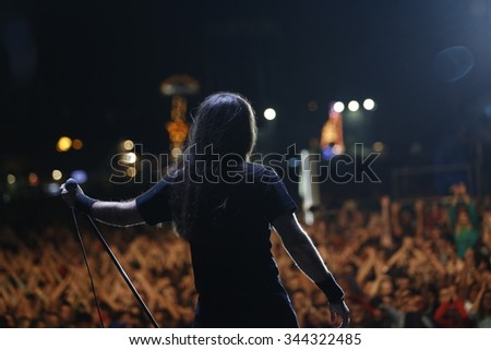 Belgrade, Serbia - August 22, 2015: The performs on stage at Traditional Beer Fest in Belgrade, next to good music to audience offered and beer, this year lasted 6 days. - stock photo