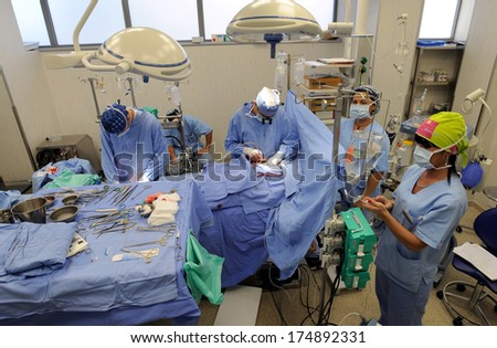 BELGRADE, SERBIA - CIRCA AUGUST 2010: Team of doctors operates heart disease patient in Belgrade clinic center, circa August 2010 in Belgrade - stock photo
