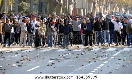"BELGRADE, SERBIA - CIRCA OCTOBER 2010: Protesters trows stones toward police during street riots at ""Belgrade Pride"" circa October 2010 in Belgrade - stock photo"