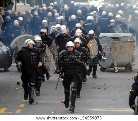 "BELGRADE, SERBIA - CIRCA OCTOBER 2010: Special force policemans runs during street riots at ""Belgrade Pride"" circa October 2010 in Belgrade - stock photo"