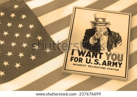 "BELGRADE, SERBIA - DEC 14: Poster of Uncle Sam reads ""I WANT YOU"" on the US Army on the American flag, Sepia tone, focus on the text "" I WANT YOU"". The poster was designed by J. M. Flagg in 1917 - stock photo"
