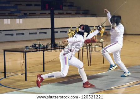 "BELGRADE,SERBIA-DECEMBER1:Fencer Chang Kaitlin(GBR) fight against Undrea Maria(ROU) on the ""57. International Trophy of Belgrade"" Undrea won.December1,2012 in Belgrade,Serbia - stock photo"
