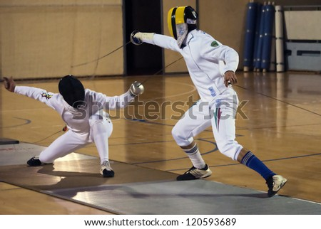 "BELGRADE,SERBIA-DECEMBER1:Fencer Cordeiro Joao(POR) fight against Serra Solt(HUN) on the ""57. International Trophy of Belgrade"" Serra won.December1,2012 in Belgrade,Serbia - stock photo"