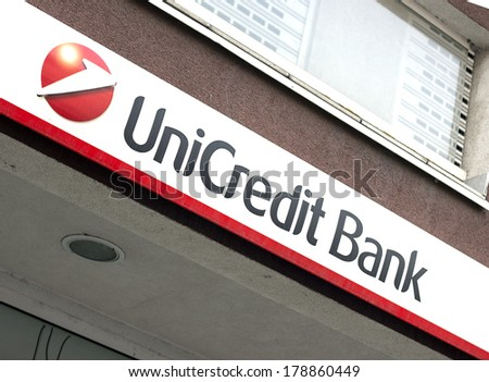 BELGRADE, SERBIA - FEBRUARY 26, 2014: Illuminated sign of Unicredit Bank on wall