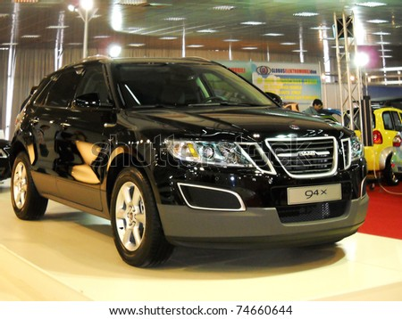 BELGRADE, SERBIA - MARCH 29: Front view of Saab 94x car on Belgrade car show, March 29, 2011 in Belgrade, Serbia - stock photo