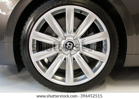 Belgrade,Serbia - March 20,2016. Silver alloy wheel on Bentley luxury car, parked