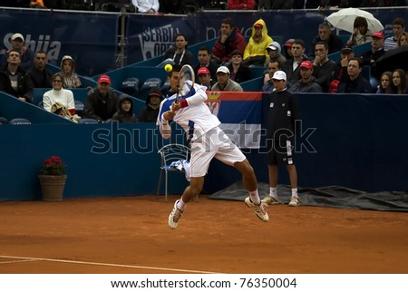 "BELGRADE, SERBIA-MAY 1: Novak Djokovic (SRB) jump and returns a ball during the final match with Feliciano Lopez (ESP) at ""2011 Serbia Open"" on May 1, 2011 in Belgrade, Serbia. Djokovic win 2:0."