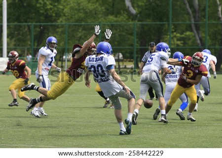 Belgrade, Serbia - May 05, 2014: Team Blue Dragons in action. American Football Match Between Belgrade Wolves And Blue Dragon in Belgrade. The Wolves team is winner.