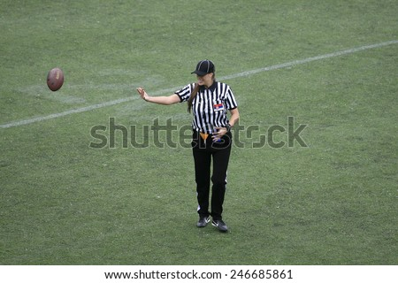 Belgrade, Serbia - May 05, 2014: The only female football referee Ivana Lazic in Serbia. American Football Match Between Belgrade Wolves And Blue Dragon in Belgrade. The Wolves team is winner. - stock photo