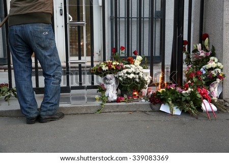 Belgrade, Serbia - November 14, 2015: In front of France Embassy in Belgrade, citizens from Serbia laying flowers and lighting candles for victims of terrorist attack in Paris.