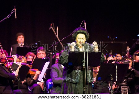 BELGRADE, SERBIA -  NOVEMBER 6: Montserrat Caballe sings with the orchestra on her solo concert in Belgrade, Serbia, November 6, 2011 - stock photo