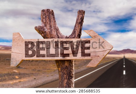 Believe direction sign with road background - stock photo