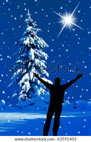 Believe! Silhouette of man with arms raised outside on a silent snowy night. - stock photo