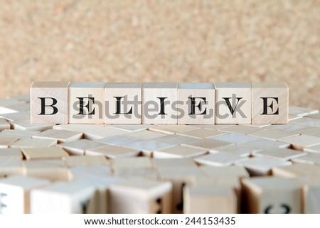 believe word on wood blocks - stock photo