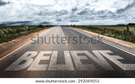 Believe written on rural road - stock photo