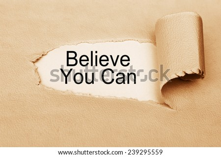 Believe You Can  written behind torn paper - stock photo