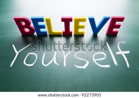 Believe yourself, Colorful words on blackboard. - stock photo