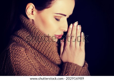 Believing woman praying to God - stock photo