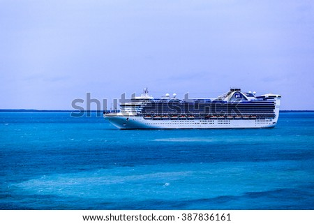 BELIZE. JAN 26 2016: Caribbean Princess Cruise Ship anchors near Belize City and ready to tender visitors to the port . She  has capacity about 3000 passengers and crew of 1150  - stock photo
