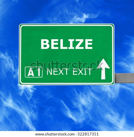 BELIZE road sign against clear blue sky