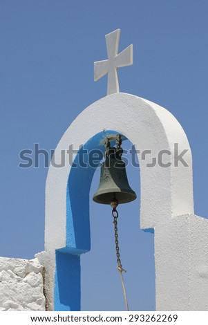 bell and cross of a small greek church - stock photo