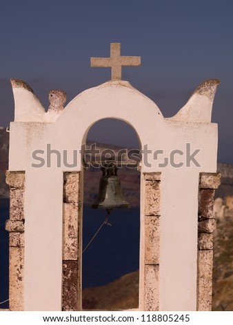 Bell and Crucifix on church in Santorini Greece