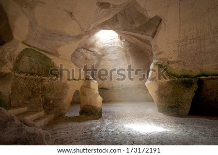 Bell Cave located at Beit Govrin, Israel. Photo taken from inside, with ray of light falling from above. - stock photo
