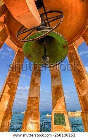 Bell of Siege Bell Memorial, Valletta, Malta - stock photo