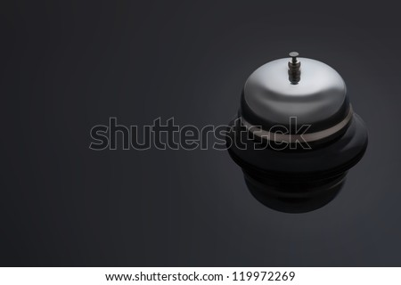 Bell on a dark background with space for text - stock photo