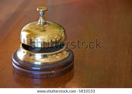bell on bellperson stand in hotel lobby - stock photo