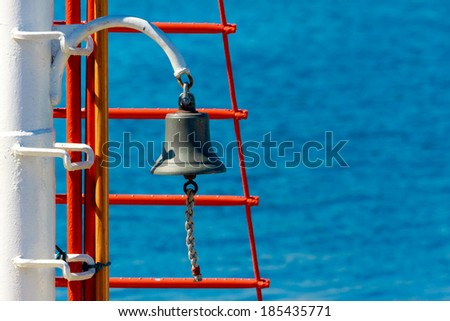 Bell on sailing ship  over the blue sea background - stock photo