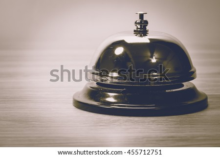 bell on wooden floor