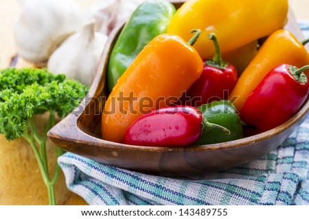 Bell Pepper, garlic and sprig of parsley - stock photo
