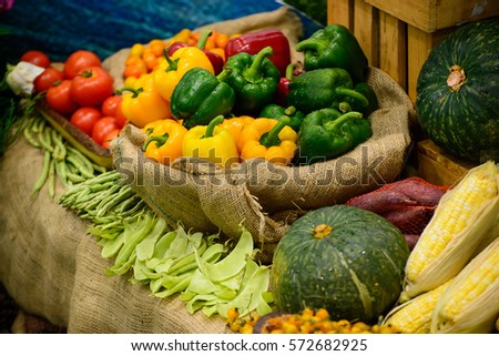 bell pepper in a basket surrounded with other vegetables, selective focus.