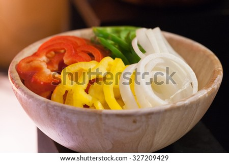 Bell pepper on the wooden bowl