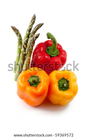 bell peppers and asparagus isolated on white - stock photo