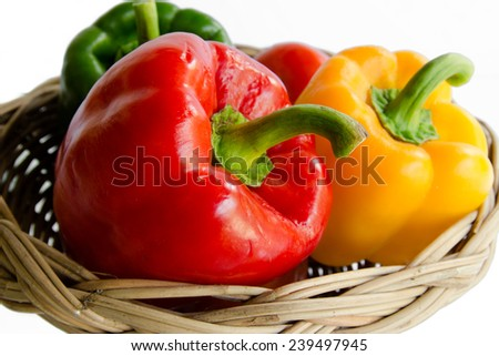Bell peppers in basket on white background