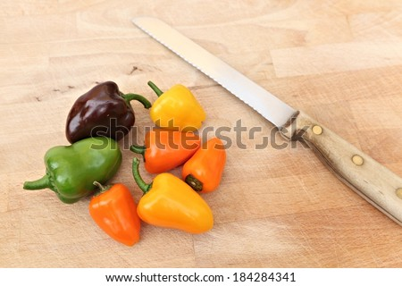 Bell Peppers on chopping board - stock photo