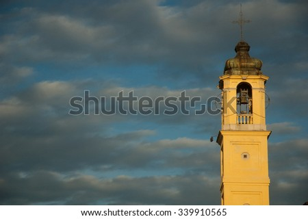 Bell tower and cloudy sky. Milan,italy