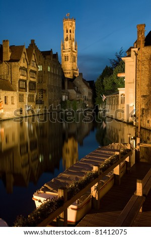 Bell Tower and old town of Bruges in Belgium by night - stock photo