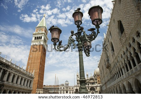 Bell tower and street lamp with facade of St Mark's Basilica. Horizontal shot. - stock photo