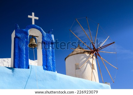 Bell Tower and Windmill at Santorini, Greece - stock photo